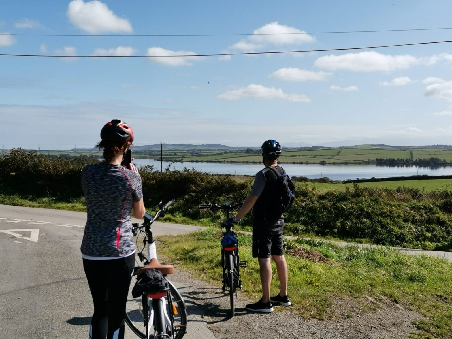 cyclists looking at Llyn Alaw, Anglesey