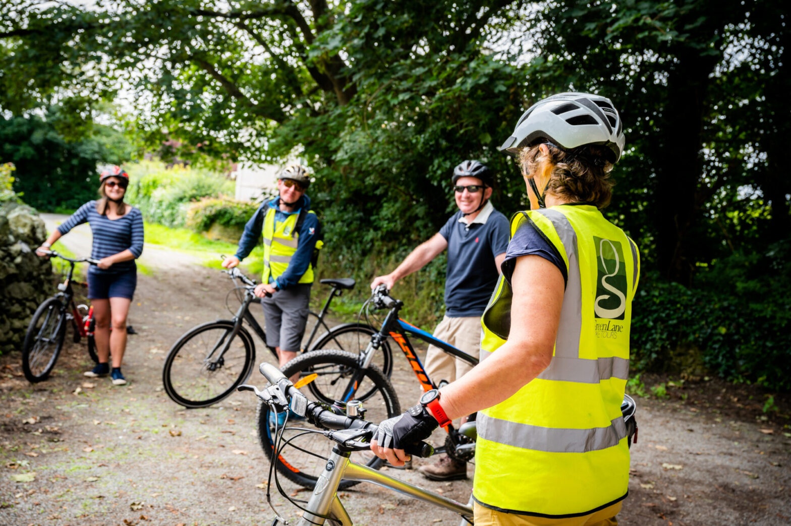 Briefing cyclists on a guided bike tour. Anglesey.