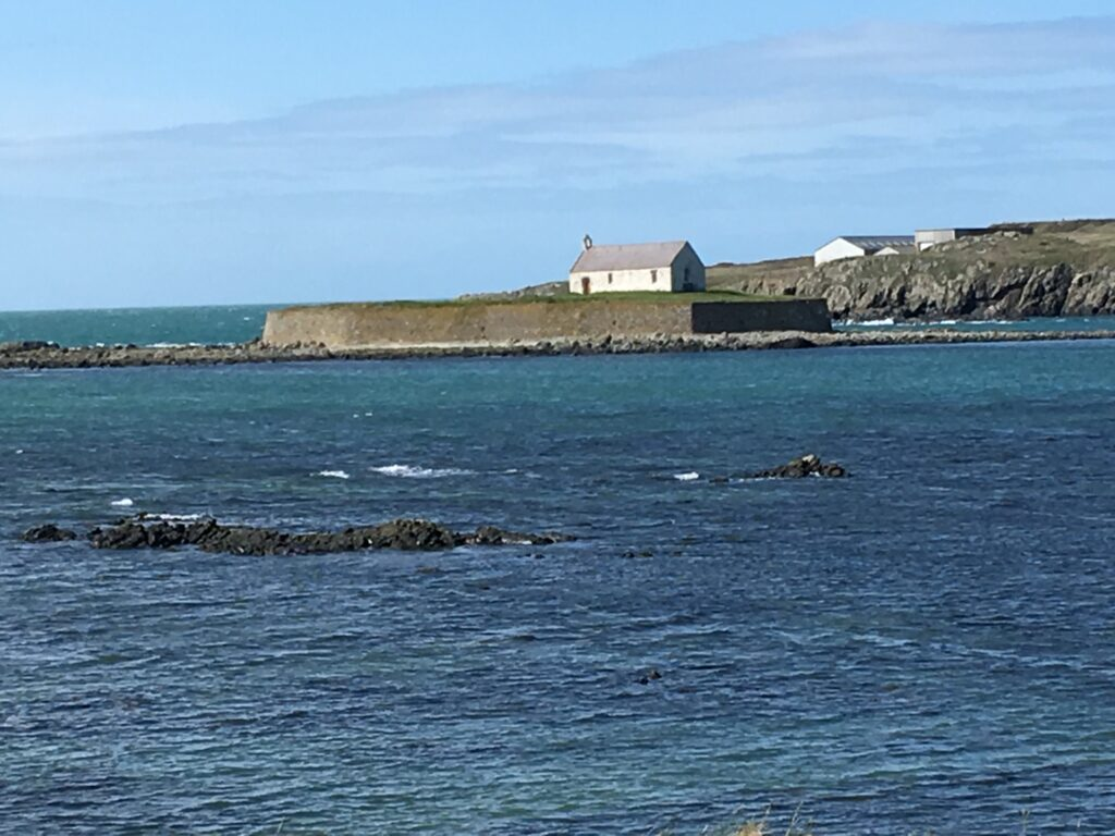 St Cwyfan's, the 'church in the sea' is marooned at high tide, off Anglesey.