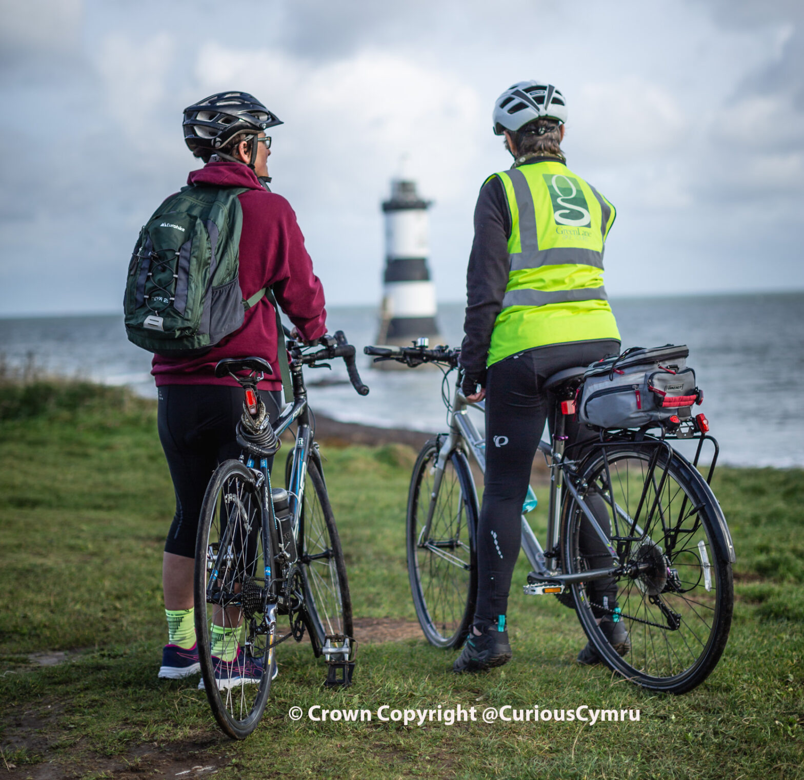 cyclists woth Green Lane Bike Tours, Penmon point lighthouse, Anglesey