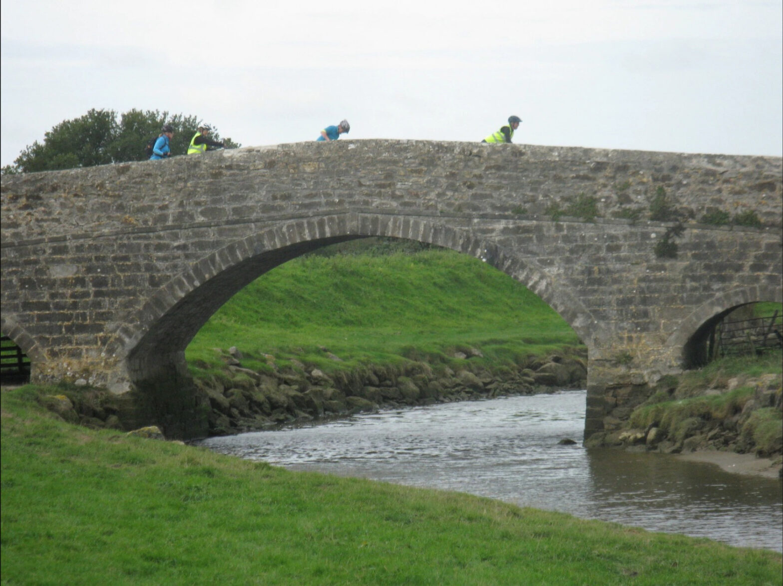 Cycling over a bridge during a Guided Bike Tour on Anglesey.
